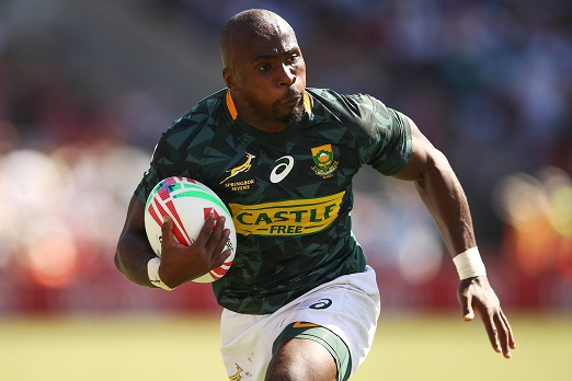 Siviwe Soyizwapi of South Africa runs the ball in the Men's 5th Place Semi Final 2 played between South Africa and Spain during the 2019 Sydney HSBC Sevens at Spotless Stadium on February 03, 2019 in Sydney, Australia. (Photo by Brendon Thorne/Getty Images)