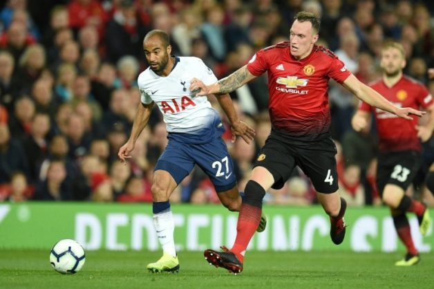Manchester United defender Phil Jones (right) has extended his contract with the club until 2023. AFP/File/Oli SCARFF
