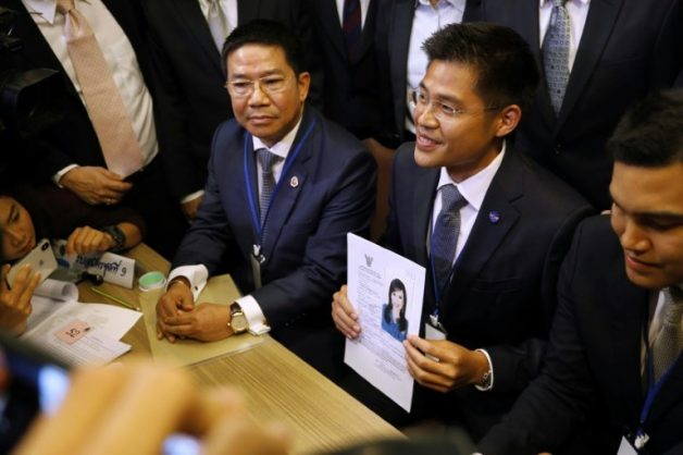 A party official holds a registration document bearing the image of Thai Princess Ubolratana, who will run for PM. THAI NEWS PIX/AFP/Krit Phromsakla Na SAKOLNAKORN
