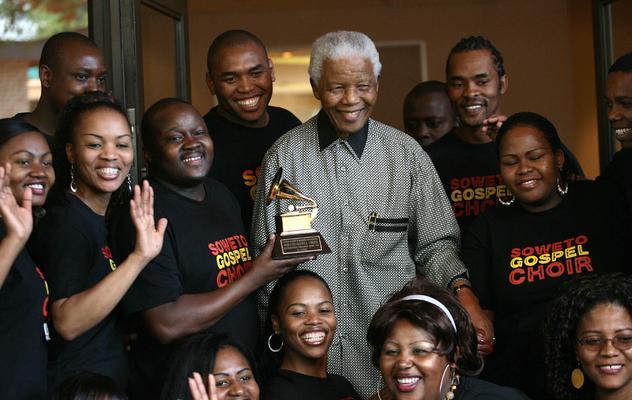 Members of the Grammy award-winning Soweto Gospel Choir visited former president Nelson Mandela in Johannesburg in March 2008. File Photo/ANA