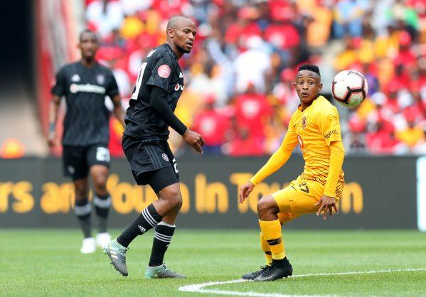 Hendrick Ekstein of Kaizer Chiefs challenged by Xola Mlambo of Orlando Pirates during the Absa Premiership 2018/19 match between Kaizer Chiefs and Orlando Pirates at FNB Stadium. (Samuel Shivambu/BackpagePix)