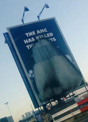 New DA 'ANC killed the lights' billboard goes up in flames