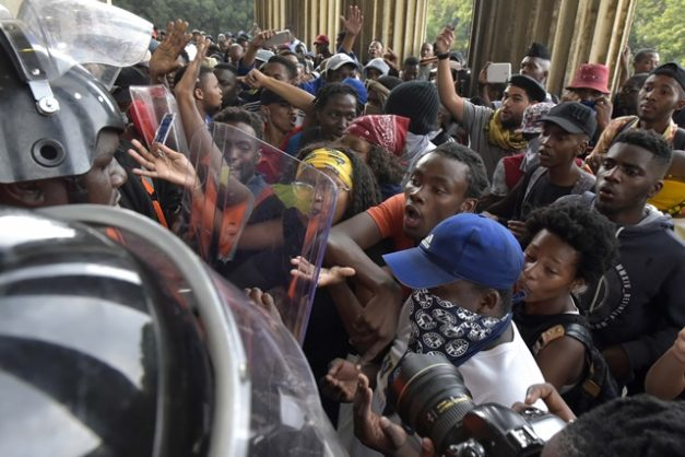 A group of protesting Wits students try to push through security to get into Solomon Mahlangu Hall, 7 January 2019. They were stopped and pushed back until police arrived to disperse the crowd. Picture: Neil McCartney