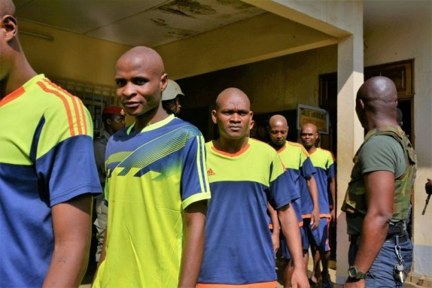 Men arrested in connection with Cameroon's anglophone crisis are seen at the military court in the capital Yaounde in December 2018 . AFP/File/STRINGER
