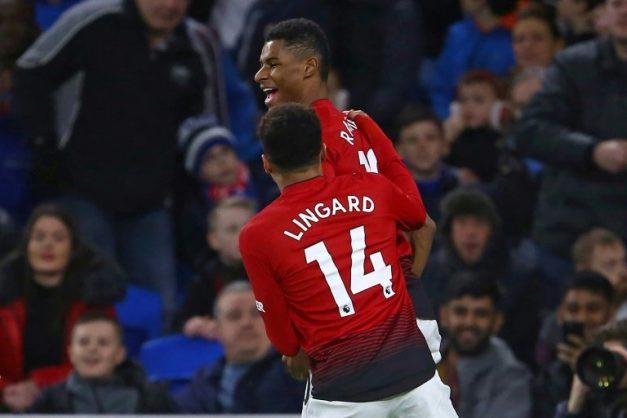 Manchester United's Marcus Rashford celebrates with Jesse Lingard. AFP/Geoff CADDICK
