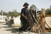 Israeli photographer revives archaic art form in border series
