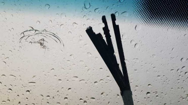 The wiper blade was ripped apart by a lightning bolt.