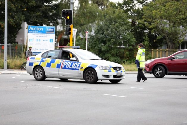 This picture released by Radio New Zealand shows a police officer cordoning a street near the mosque after a firing incident in Christchurch on March 15, 2019. - A gunman opened fire inside the Masjid al Noor mosque during afternoon prayers, causing multiple fatalities. (Photo by - / RADIO NEW ZEALAND / AFP) / New Zealand OUT / XGTY
