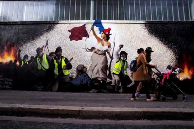 "A mural in Paris celebrating the ""yellow vests"" revolt. Picture: EPA"