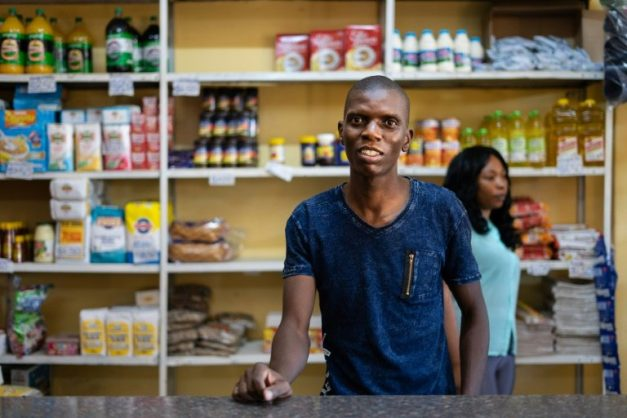 Grocery store owner Blessing Mushonga in his shop in Rimuka township, Kadoma. Life is getting harder for many Zimbabweans as the economic crisis worsens -- daily necessities are often in short supply. AFP/File/ZINYANGE AUNTONY