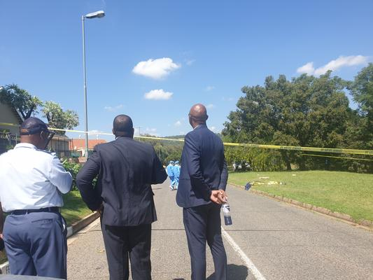 Police officials at the scene of the stabbing of a Mondeor High school pupil. PHOTO: ANA