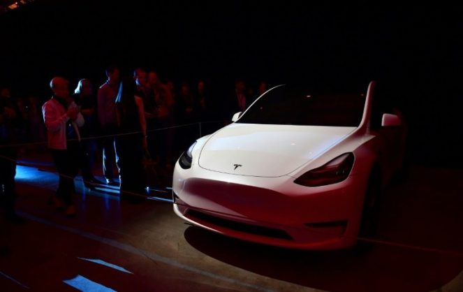 People view the new Tesla Model Y unveiled in Hawthorne, California. AFP/Frederic J. BROWN