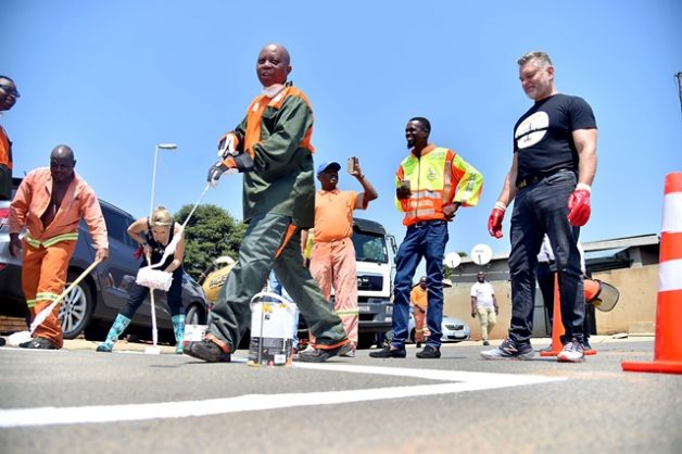 Joburg Mayor Herman Mashaba helping to paint traffic markings on the roads of Pimville, Soweto, 6 March 2019. Picture: Nokuthula Mbatha / African News Agency / ANA