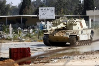 Libyan capital rocked by explosions, air strikes as death roll rises