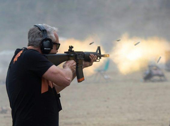 A man fires a machine gun on the main firing line during the Knob Creek Machine Gun Shoot. AFP/Andrew CABALLERO-REYNOLDS