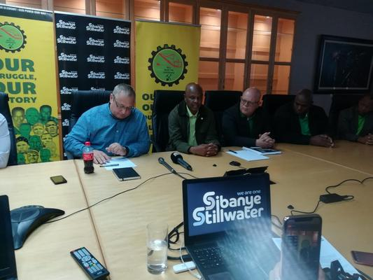 Sibanye-Stillwater CEO Neal Froneman and AMCU president Joseph Mathunjwa sign a three-year wage agreement at Sibanye's Driefontein on April 17, ending a strike that started last November. FILE PHOTO: Supplied by AMCU