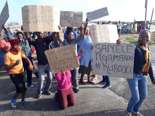Angry protesters, aggrieved over the lack of electricity, torched an Algoa bus and Isuzu bakkie in Port Elizabeth on Wednesday Photo: Supplied