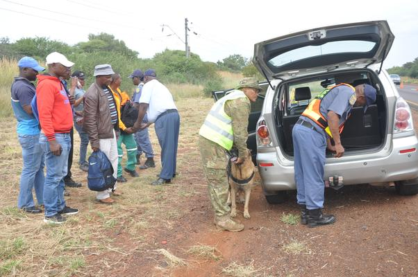 Police search a vehicle during a roadblock on the R510 road as part of the launch of the North West province's Easter road safety campaign. PHOTO: ANA