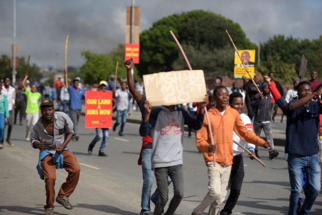 Protesters in Alexandra township in Johannesburg shut down the township over lack of service delivery, 3 April 2019. Roads were barricaded and blocked with burning tyres, as hundreds marched demanding better basic services. Picture: Tracy Lee Stark
