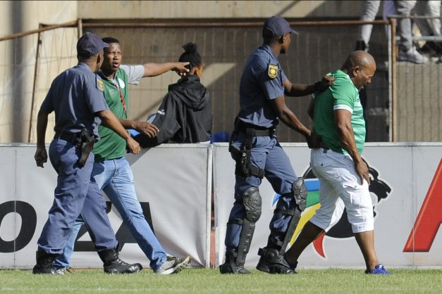 Man being arrested during the Absa Premiership match between Bloemfontein Celtic and Cape Town City FC at Dr Molemela Stadium on April 14, 2019 in Bloemfontein, South Africa. (Photo by CharlŽ Lombard/Gallo Images)