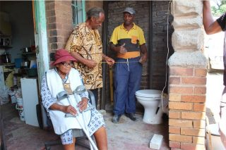 Alex businessman builds toilet for a 96-year-old granny