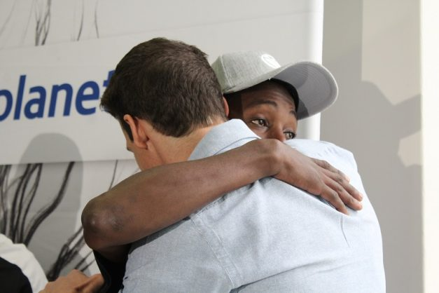 Survivor Gareth Utton embraces his hero Karabo Thosago who is emotional after receiving a life guard course. Photo: Ashtyn Mackenzie