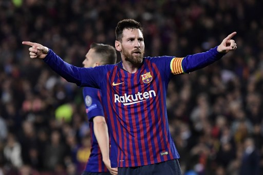 Barcelona's Argentinian forward Lionel Messi celebrates after scoring his team's third goal during the UEFA Champions League semi-final first leg football match between Barcelona and Liverpool at the Camp Nou Stadium in Barcelona on May 1, 2019. (Photo by JAVIER SORIANO / AFP)