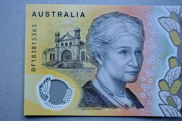 This photo illustration shows the detail in Australia's state-of-the-art new 50 dollar banknote in Sydney on May 9, 2019, with a spelling mistake in the microprint of a speech by Australia's first woman parliamentarian Edith Cowan. - The yellow and green note came into circulation last October, but it took seven months for the public to notice