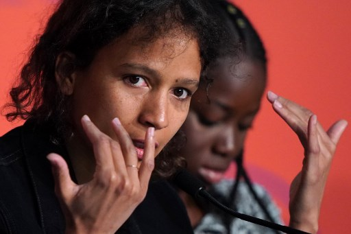 French actress and film director Mati Diop speaks during a press conference for the film