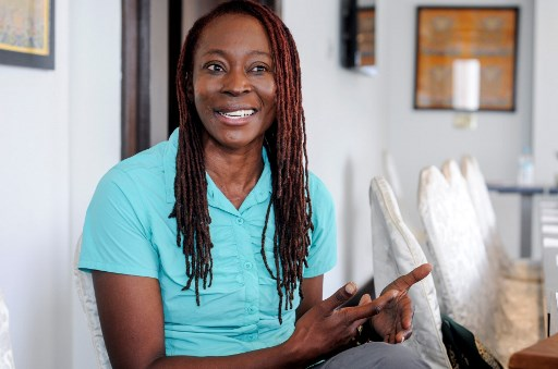 South African climber Saray Khumalo speaks to AFP in an interview in Kathmandu on May 23, 2019, after her record breaking climb to be the first black African woman to summit Everest. - The business executive who became the first black African woman to climb Mount Everest said on May 22 that knowing her climb would be in the record books helped her push on to the top. (Photo by Bikash KARKI / AFP)