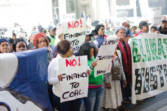 Protesters gathered outside Standard Bank's head office on Thursday calling for shareholders to vote for the resolution, and delivering a message to the entire business sector – get your environmental ducks in a row or it's going to get noisy. Image: Moneyweb