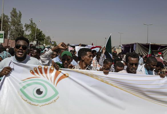"FILE - In this April 28, 2019, file photo, protesters chant against military rule and demand the prosecution of former officials, at the Armed Forces Square, in Khartoum, Sudan. The Sudanese protesters who succeeded in driving President Omar al-Bashir from power last month say their revolution won't be complete until they have dismantled what many describe as an Islamist-dominated ""deep state"" that underpinned his 30-year rule.  (AP Photo/Salih Basheer, File)"