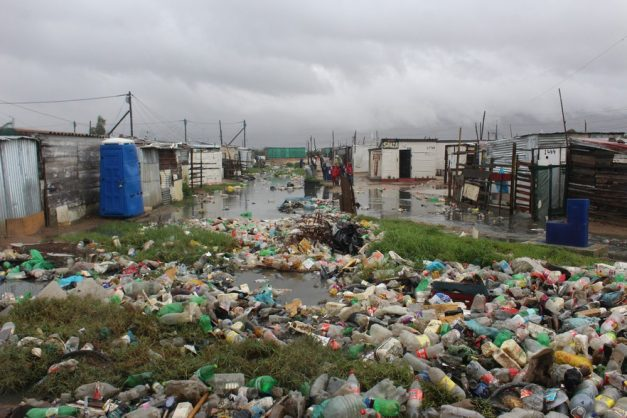 Flooded canals carry litter with them. This is in Pholile, Strand. Photo: Velani Ludidi/GroundUp