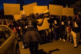 Residents from dark township march through well-lit Rondebosch to demand better lighting