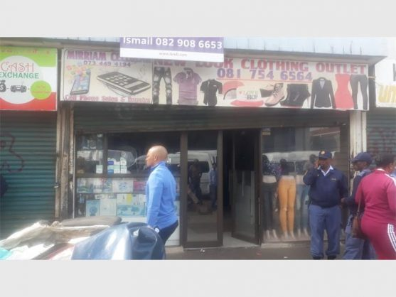 Police intervening at the shop and salon where drugs were allegedly being sold.