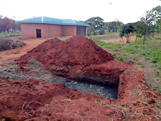 Raw sewage is being dumped into trenches.