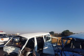 One dead, seven injured in head-on taxi crash