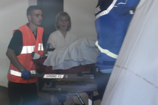 Rescue workers are seen through a window as they transport Team Ineos rider Great Britain's Christopher Froome in a stretcher upon arrival at the Centre Hospitalier after he fell on a training run ahead of the fourth stage of the 71st edition of the Criterium du Dauphine cycling race, in Roanne on June 12, 2019. - Chris Froome will miss the Tour de France after being seriously injured in a training accident at the Criterium du Dauphine on June 12, Team Ineos leader Dave Brailsford has confirmed. A witness said Froome probably suffered a bone fracture, without giving further details. (Photo by Anne-Christine POUJOULAT / AFP)
