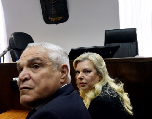 Sara Netanyahu, wife of Israeli Prime Minister Benjamin Netanyahu, and her lawyer Yossi Cohem (L) wait for the judge to arrive at the Magistrate's Court in Jerusalem on June 16, 2019. - Sara asked a Jerusalem court to approve a plea bargain convicting her for fraudulently used state funds for meals, an AFP reporter said. (Photo by DEBBIE HILL / AFP)