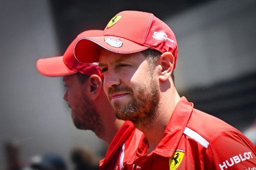 Ferrari's German driver Sebastian Vettel poses in the paddock at the Circuit Paul Ricard in Le Castellet, southern France, on June 20, 2019, a few days ahead of the Formula One Grand Prix de France. (Photo by GERARD JULIEN / AFP)