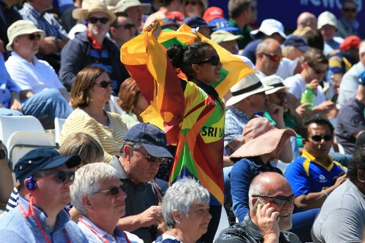 A Sri Lankan supporter cheers during the 2019 Cricket World Cup group stage match between Sri Lanka and South Africa at the Riverside Ground, in Chester-le-Street, northeast England, on June 28, 2019. Picture: Lindsey PARNABY / AFP
