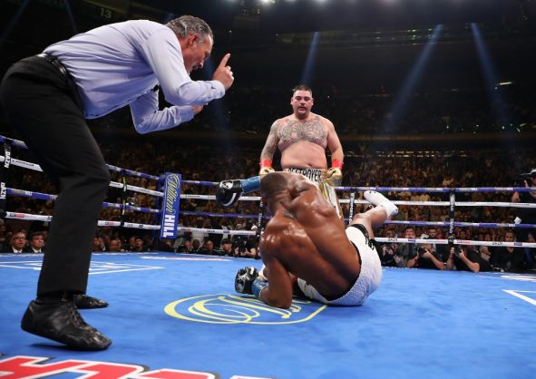 NEW YORK, NEW YORK - JUNE 01: Andy Ruiz Jr knocks down Anthony Joshua in the third round during their IBF/WBA/WBO heavyweight title fight at Madison Square Garden on June 01, 2019 in New York City.   Al Bello/Getty Images/AFP