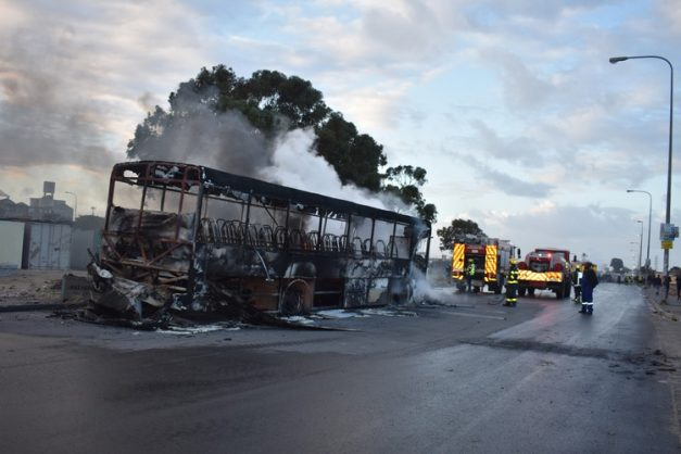 A bus was set alight during a protest for toilets and taps in Philippi on Wednesday. Photo: Velani Ludidi