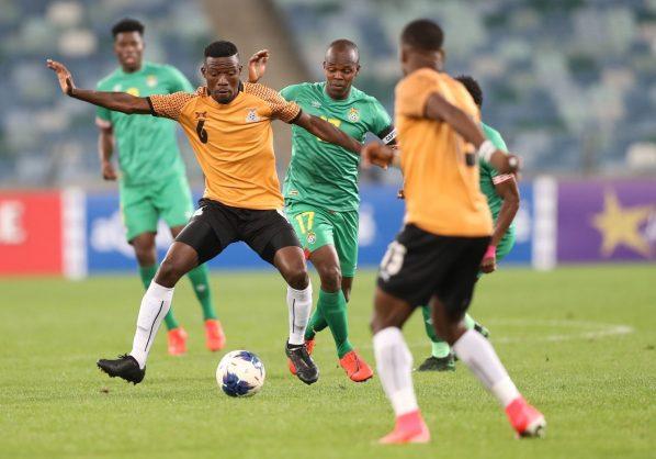 Benson Sakala of Zambia challenged by Knowledge Musona of Zimbabwe during the 2019 Cosafa Cup semifinals match between Zimbabwe and Zambia at Moses Mabhida Stadium. (Samuel Shivambu/BackpagePix)