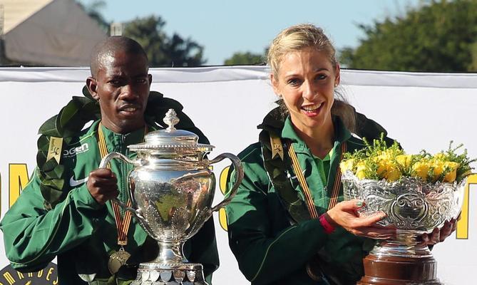 South Africa - Durban - 09 June 2019 - Two champions Edward Mothibi and Gerda Steyn on the podium in the  94th Comrades Marathon spans 89km from Durban to Pietermaritzburg. Picture: Motshwari Mofokeng/African News Agency(ANA)