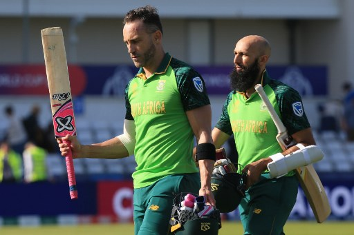 "South Africa's captain Faf du Plessis (L) and South Africa's Hashim Amla leave the field at close of play during the 2019 Cricket World Cup group stage match between Sri Lanka and South Africa at the Riverside Ground, in Chester-le-Street, northeast England, on June 28, 2019. - South Africa beat Sri Lanka by nine wickets. (Photo by Lindsey PARNABY / AFP) / RESTRICTED TO EDITORIAL USE / ""The erroneous mention[s] appearing in the metadata of this photo by Lindsey PARNABY has been modified in AFP systems in the following manner: [Faf du Plessis (L)] instead of [Faf du Plessis (R)]. Please immediately remove the erroneous mention[s] from all your online services and delete it (them) from your servers. If you have been authorized by AFP to distribute it (them) to third parties, please ensure that the same actions are carried out by them. Failure to promptly comply with these instructions will entail liability on your part for any continued or post notification usage. Therefore we thank you very much for all your attention and prompt action. We are sorry for the inconvenience this notification may cause and remain at your disposal for any further information you may require."""