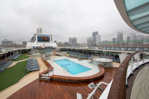 In this picture taken on July 16, 2019 Yokohama skyline is seen from the rooftop of Sun Princess cruise ship, docked in the port. - Olympic fans are expected to pour into Tokyo for next year's Games, but the city is facing a shortage of hotel rooms, so officials are looking offshore -- to floating hotel ships. (Photo by Behrouz MEHRI / AFP) / TO GO WITH AFP STORY