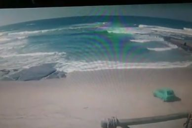 WATCH: Man responds to dare, drives his car into the sea