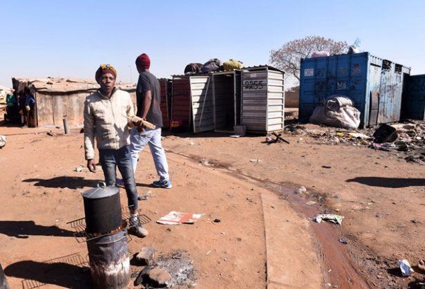 Busi Zwane prepares water in front of the R1.9 billion tender toilets in Tembisa , Ekurhuleni, 11 July 2019. Picture: Nigel Sibanda