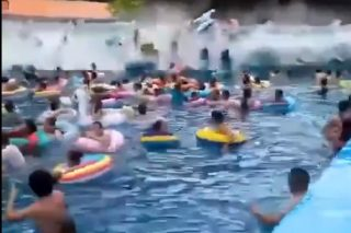 WATCH: Giant wave sweeps away tourists at waterpark